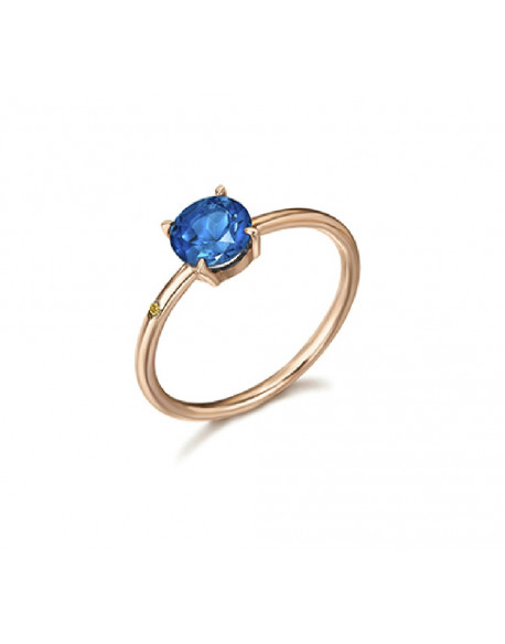 Anillo de oro rosa con topacio london azul y un diamante de 0.004 quilates